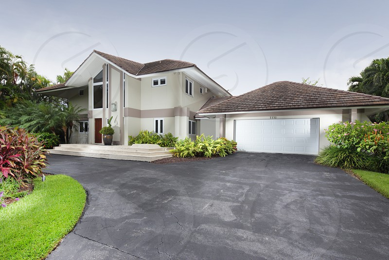 Luxury single family home with garage photo