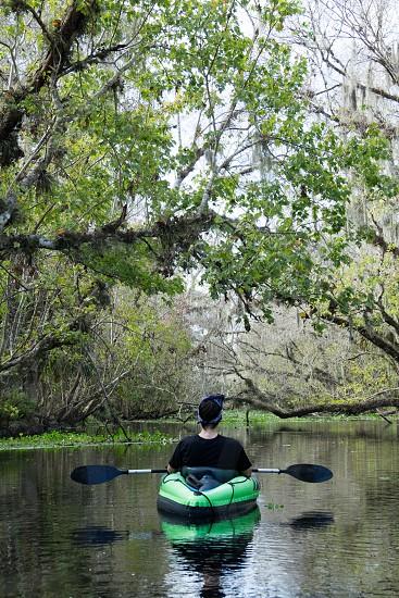 Taking in the beauty of snake creek near Blue Springs FL kayaking wanderlust nature travel outdoors vertical one man Caucasian trees river freshwater   photo