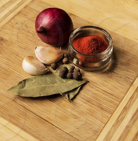 Spices on the wooden background photo