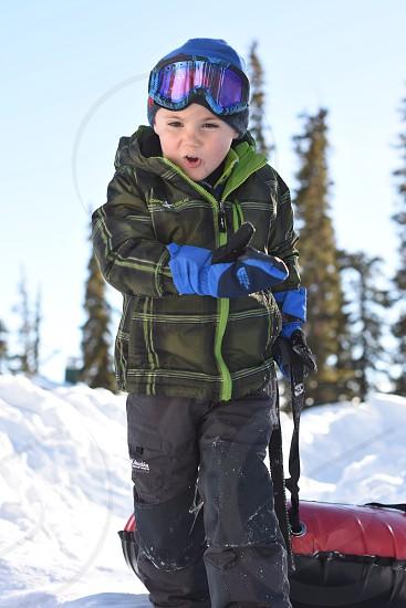 Snow sports ski tubing boy child photo