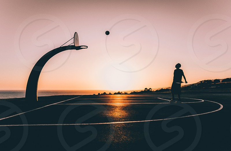 Basketball b-ball sunset shadow silhouette sun beach  photo