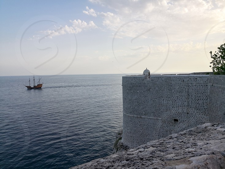 a view of the adriatic sunset from the walls of dubrivnik photo