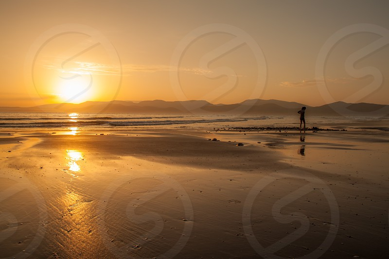 person on shoreline in a sunny day photo photo