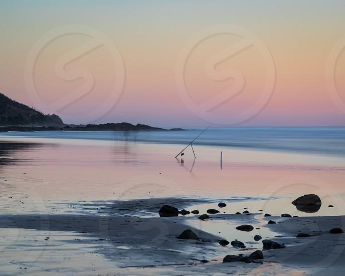 Ocean dusk beach fishing summer light surf long exposure fishing rod pinks blue surf coast Wye River Australia sand blue hour balance photo