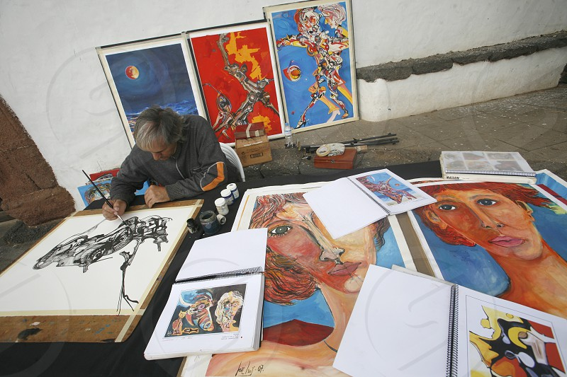the sunday market in the old town of Teguise on the Island of Lanzarote on the Canary Islands of Spain in the Atlantic Ocean. on the Island of Lanzarote on the Canary Islands of Spain in the Atlantic Ocean. photo
