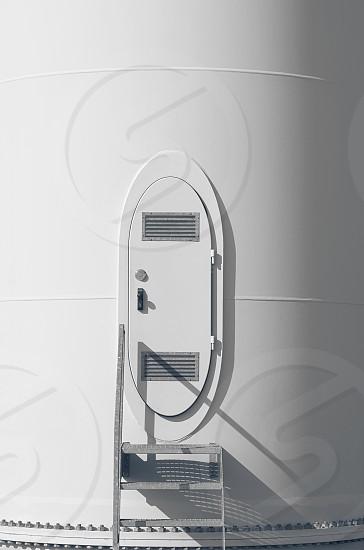 White Wind Turbine Steel Door Side Lit Closeup photo