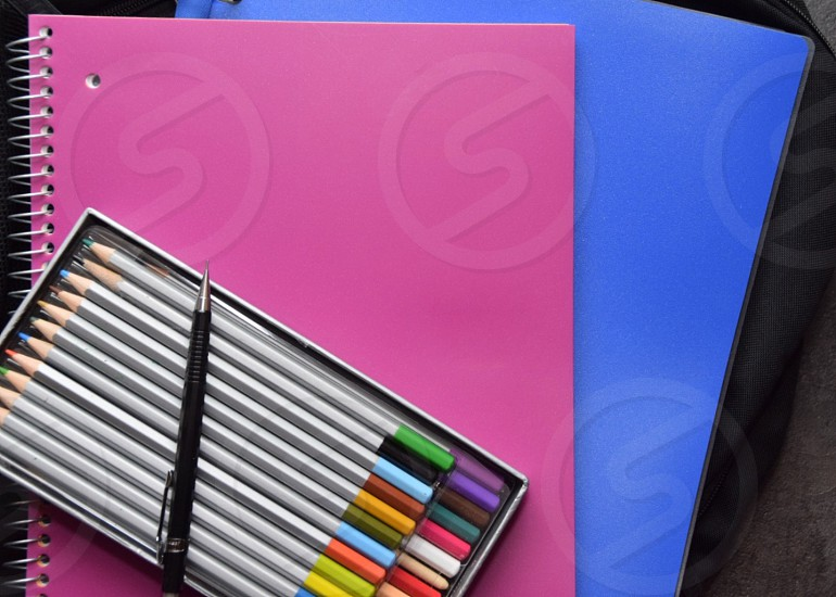 Education Colorful notebooks and pencils lay flat  photo