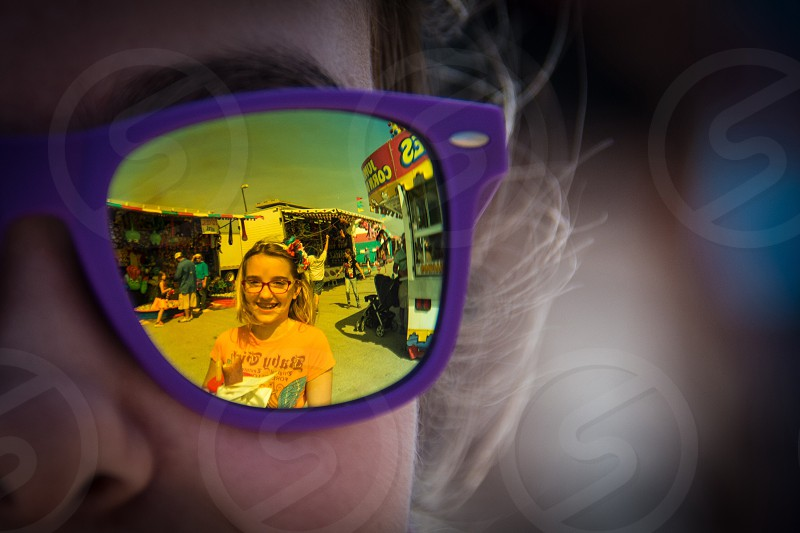 person wearing purple framed sunglasses photo
