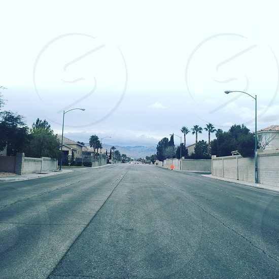 empty gray concrete road during daytime photo