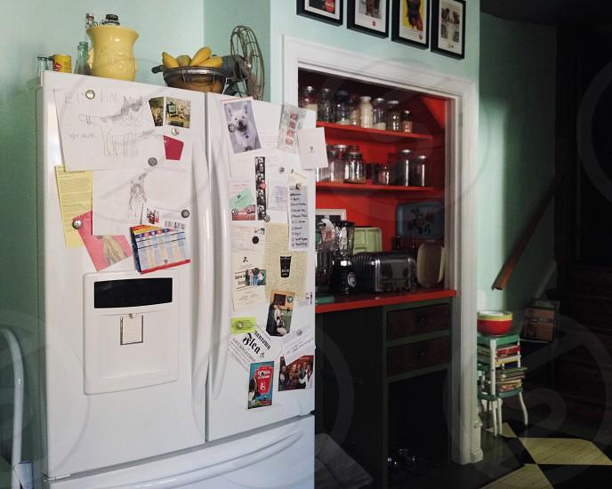 Refrigerator kitchen clutter magnets life list reminders fridge white  green orange storage appliance vintage photo