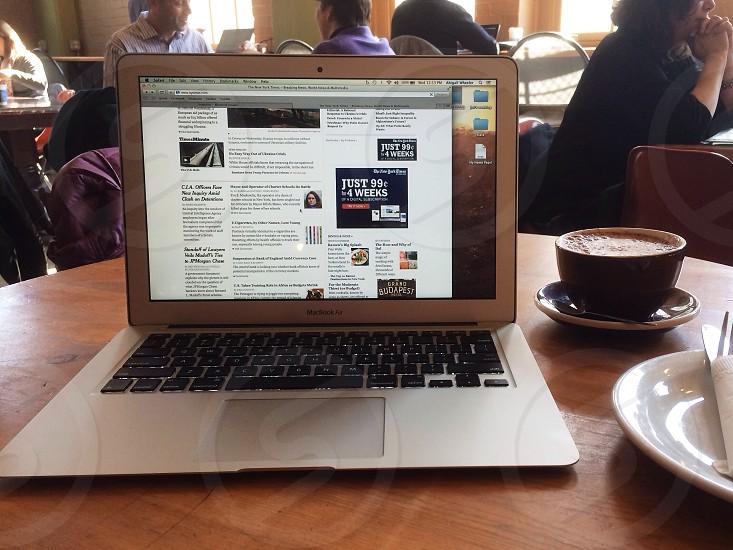 mac book air on table near coffee photo