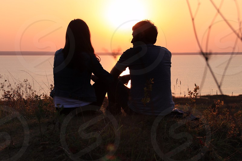 silhouette couple in love on the sunset photo