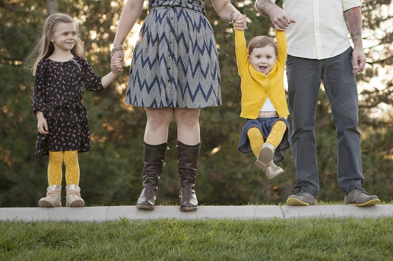 family kids sisters mother father daughters happy holding hands fun love photo