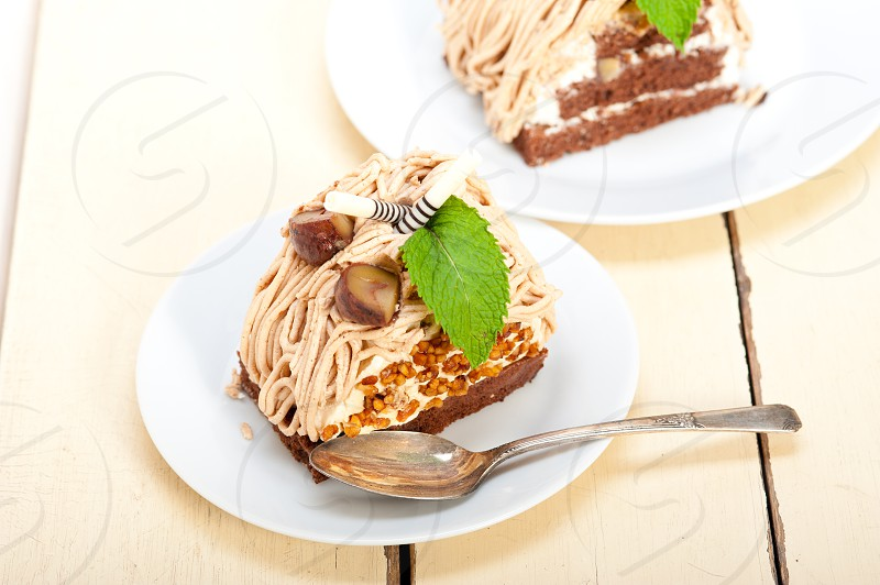fresh baked chestnut cream cake dessert over rustic white wood table  photo
