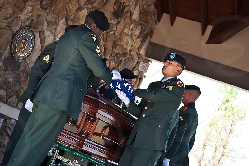 group of soldiers around a casket photo