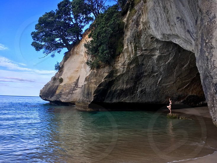 Girl posing at Cathedral Cove Hahei New Zealand.  photo