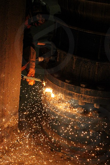 Welding work weld labor union job man hot sparks fire person bright indoors working photo
