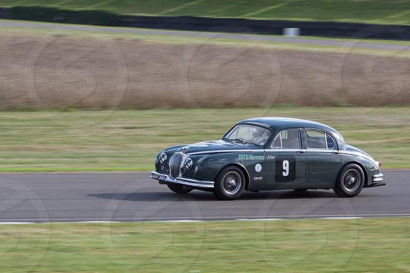 GOODWOOD WEST SUSSEX/UK - SEPTEMBER 14 : Vintage Racing at Goodwood on September 14 2012. One unidentified person photo