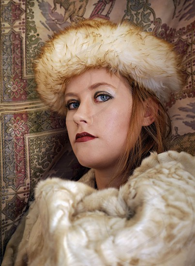Russian woman in vintage fur coat and hat photo