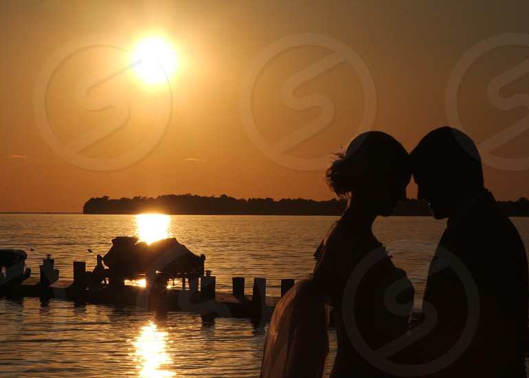 Couple looking at each other at sunset photo