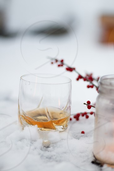 canadian whiskey scotch winter snow cold drinks cocktails outdoor glass photo
