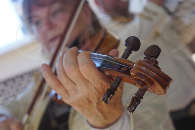 Mariachi violin playing hand gesture  photo