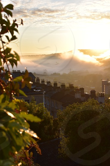 Early morning view over rooftops and countryside. photo