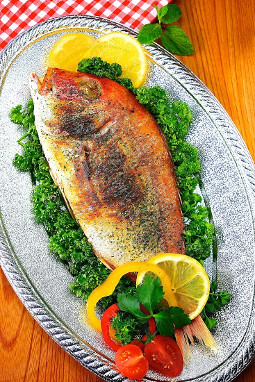 Cooked Whole white fish-nature wood and table cloth background photo