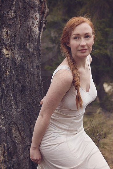 woods outdoor red hair young woman girl long hair photo