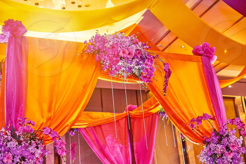 The colorful stage decoration with bright shade of color for bride and groom in the sangeet night of traditional indian wedding party celebration photo