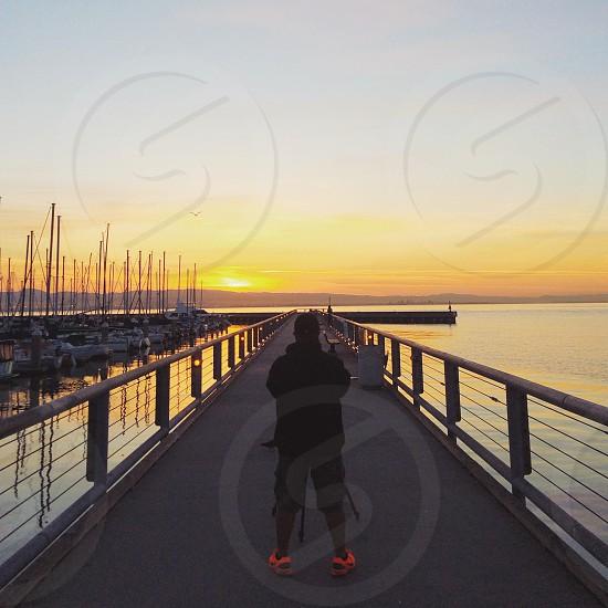 man wearing black suit viewing sunset photo