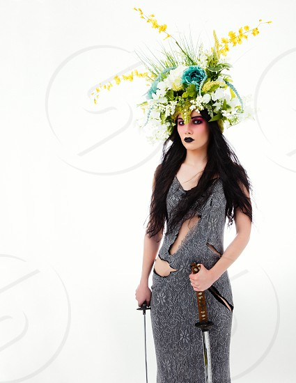 Warrior princess with a flower head dress photo