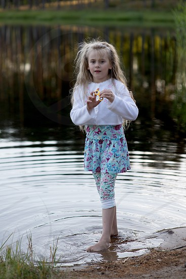 Little beautiful girl at the lake photo