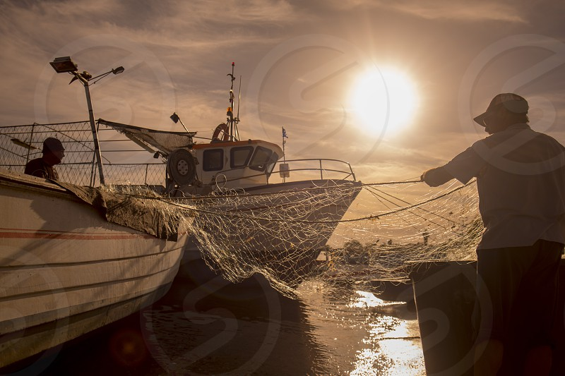 a fishermen at teh evening the Town of Cabanas near Tavira at the east Algarve in the south of Portugal in Europe. photo