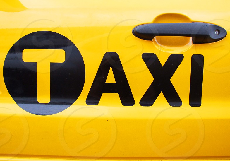 Detail of a door of a yellow NYC taxi photo