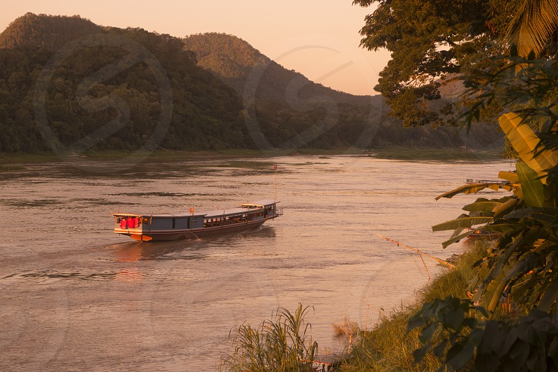 the Landscape at the Mekong River in the town of Luang Prabang in the north of Laos in Southeastasia. photo