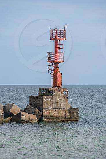 Grigoryevka Ukraine - 05.09.2019. The lighthouse at the entrance to Adzhalyk estuary from the Black Sea. Sea gate to the South Trade Port in Ukraine photo
