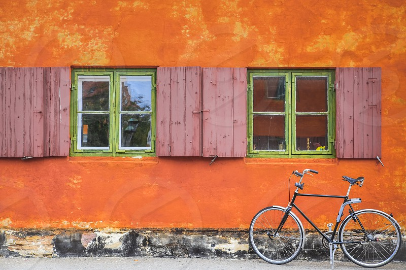 Orange wall and vintage bicycle windows in Copenhagen City photo