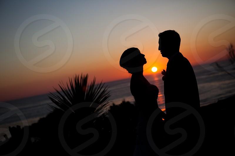 man and woman at sunset photo