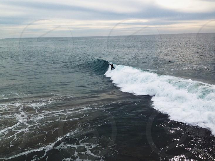 man surfing in the ocean  photo