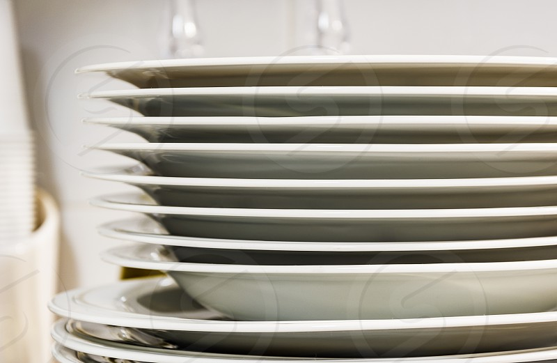 view of a group of stacked dishes in a modern kitchen photo