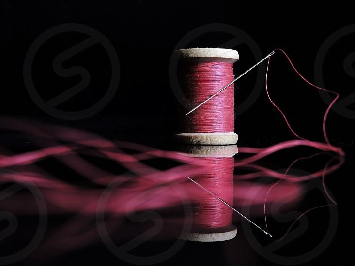 pink spool of thread photo