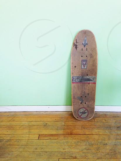 brown skate board on brown wooden floor photo
