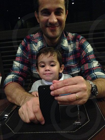 man and child with smartphone photo