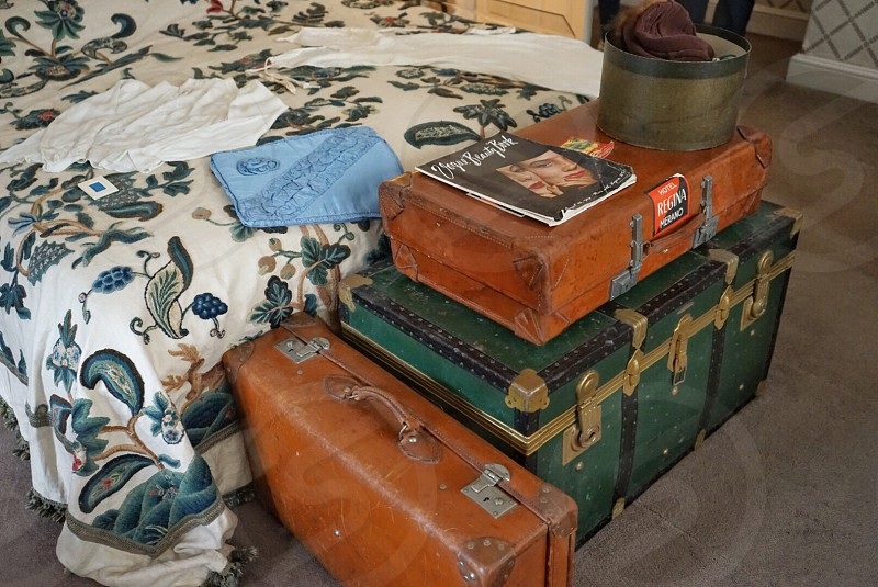 Suitcases at the end of a bed ready to travel United kingdom photo