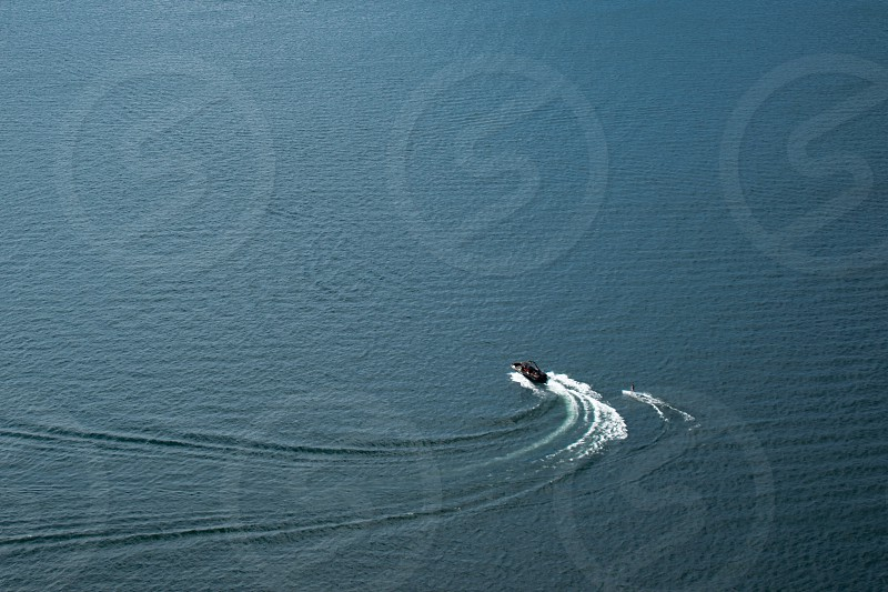 boat and wake board on the water photo