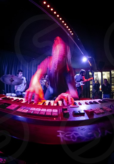 Savona Italy 23/02/2019: Pianist on the move during a concert of grunge music organized in a social center in Savona photo