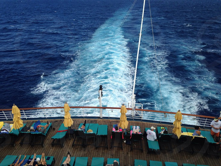 Cruising blue ocean wake photo
