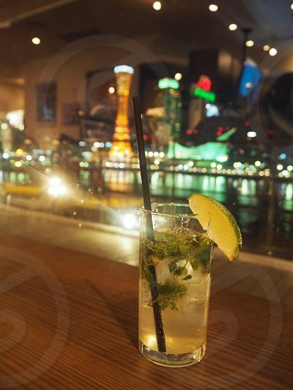 Enjoying mojito and night view at Hurbarland in KobeJapan photo