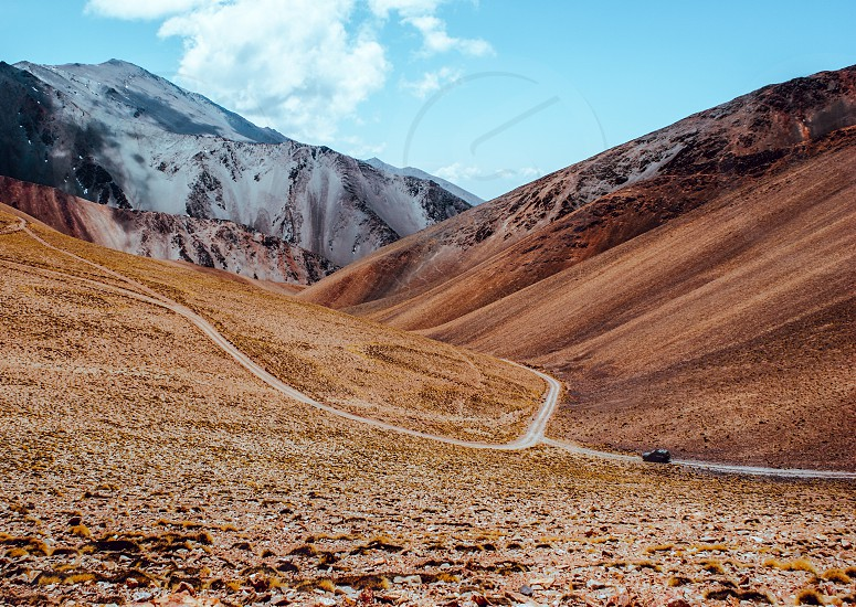 crossing in 4 x 4 by roads off route in the Argentine north between the mountains valleys and rivers photo
